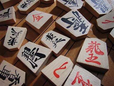 Scattered shogi pieces (photo credit: chidorian on flickr.com)